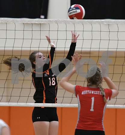 10/11/2017 Mike Orazzi | Staff Terryville's McKenzie Huria (18) and Northwestern's Samantha Sage (1) during Wednesday night's volleyball match in Terryville.