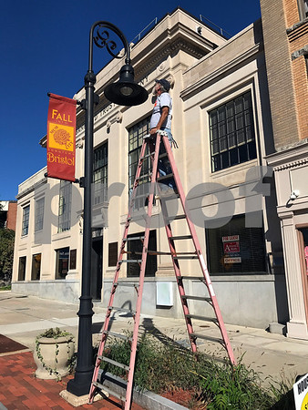 10/12/2017 Mike Orazzi   Staff Bert Turcotte of J&B Electrical Services while working on street lights on Main Street Thursday afternoon.