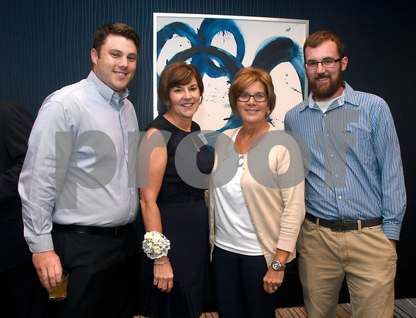 10/12/2017 Mike Orazzi   Staff PLUS award winner Eileen Adams (second from left) with her sons Steve and Tom along with her sister Margaret DeMaria during The Boys & Girls Club of Bristol Family Center's 33rd Annual Humanitarian Awards Dinner held at the DoubleTree by Hilton Hotels in Bristol Thursday evening. Members of the the McCarthy family received the Oliver Gaudreau award.