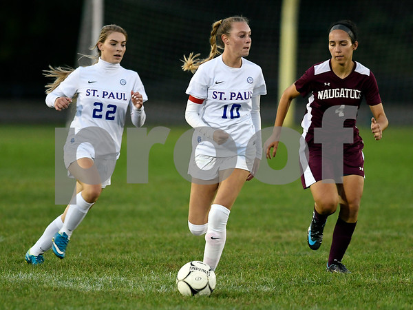 10/13/2017 Mike Orazzi | Staff St. Paul's Hannah Rinehart (22) and Kendall Davis (10) and Naugatuck's Alyana Sosa Catarina Rego (4) in Bristol Friday night.