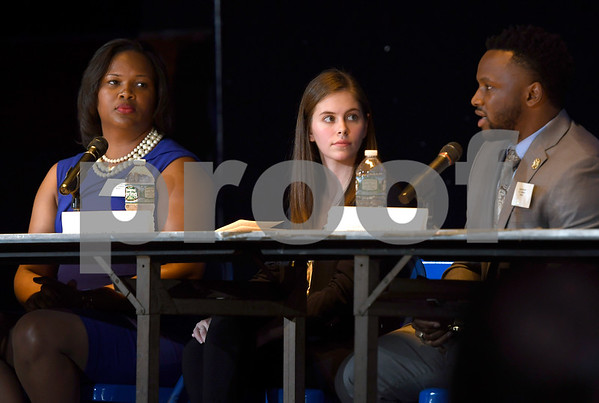 10/14/2017 Mike Orazzi | Staff Council candidates Veronica DeLandro, Molly McGuire and Lamar Bowsky during The League of Women Voters debate held at Trinity on Main Saturday afternoon.