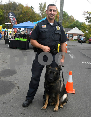 10/14/2017 Mike Orazzi | Staff Berlin Police Department officer Brandon Lagueux and his partner police dog Bane,4, during the A.S. Labieniec farm store grand re-opening on Saturday in Berlin.