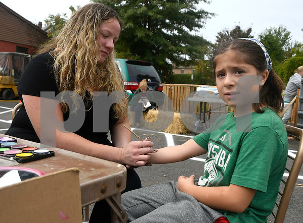 10/14/2017 Mike Orazzi | Staff Tori Florian paints a symbol on Madeline Fusco's arm during the A.S. Labieniec farm store grand re-opening on Saturday in Berlin.