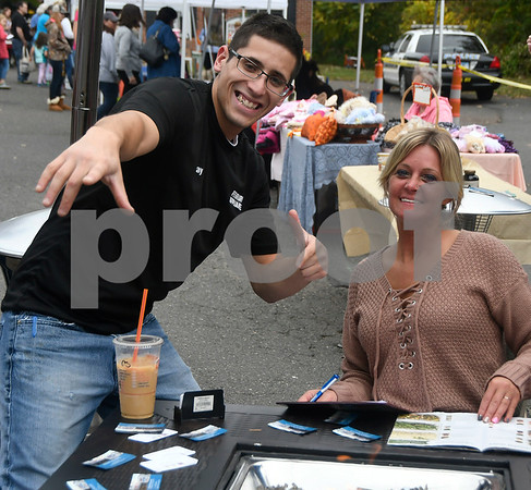 10/14/2017 Mike Orazzi | Staff Ray Rodriguez and Stacy Ferrari of Ferraris Appliance during the A.S. Labieniec farm store grand re-opening on Saturday in Berlin.