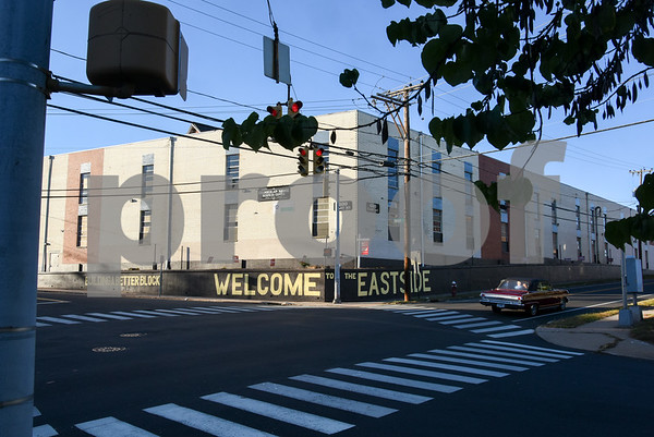 10/18/17 Wesley Bunnell | Staff A car drives down East St. where Building a Better Block Welcome to the Eastside was recently painted on the corner of East & Dwight St. by Paul Baylock and Aaron Pryzbek.