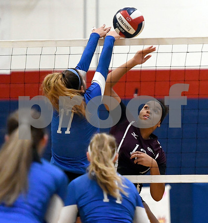 10/19/2017 Mike Orazzi | Staff Plainville's Katharine Tanguay (17) and Bristol Central's Xia'ian Carrasco (13) during Thursday's volleyball match in Plainville.