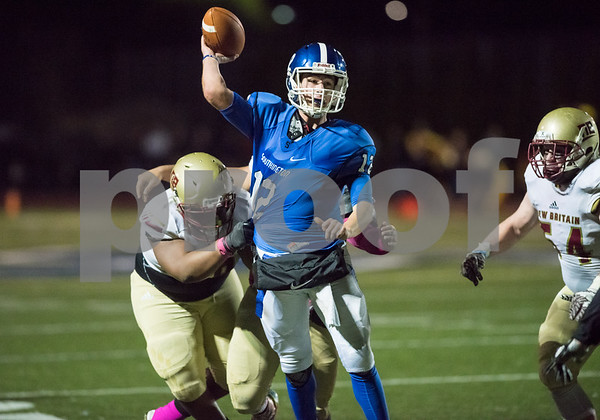 10/20/17 Wesley Bunnell | Staff New Britain vs Southington football on Friday evening at Southington High School. William Barmore (12) eludes New Britain defensive players with a short touchdown throw.
