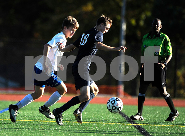 10/20/2017 Mike Orazzi | Staff Bristol Eastern's Gabe Soucy (4) and RHAM's Jack Salan (10) during Friday's soccer in Bristol.