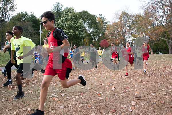 10/23/17 Wesley Bunnell | Staff Middle school students from New Britain and Enfield competed in a cross country event on Monday afternoon at Stanley Quarter Park. The boys at the start of their race.