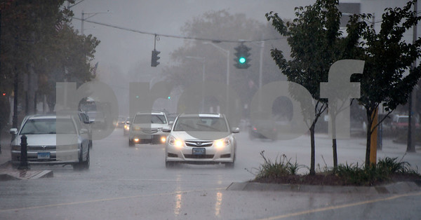10/24/2017 Mike Orazzi | Staff Motorists drive on North Main Street during a heavy downpour of rain Tuesday afternoon.
