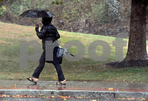 10/24/2017 Mike Orazzi | Staff A pedestrian walks along North Main Street in Bristol during a heavy downpour of rain Tuesday afternoon.