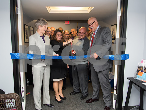 10/24/17 Wesley Bunnell | Staff New Britain EMS held a ribbon cutting for its new expanded location at 1 Herald Square on Tuesday evening. New Britain EMS Board Chair Janis Jerman, Mayor Erin Stewart, New Britain Captain of Professional Standards in Training Patrick Ciardullo and New Britain CEO Bruce Baxter.