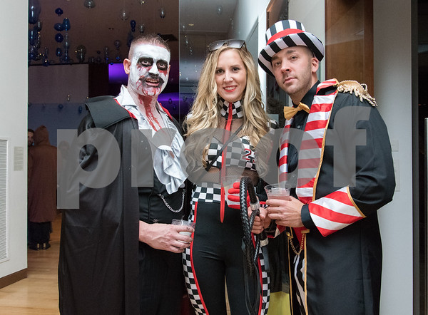 10/27/17 Wesley Bunnell | Staff The New Britain Museum of American Art held their Museum After Dark 11th Annual Halloween Bash on Friday evening. Guests pose for a photo including two of New Britain's bravest.