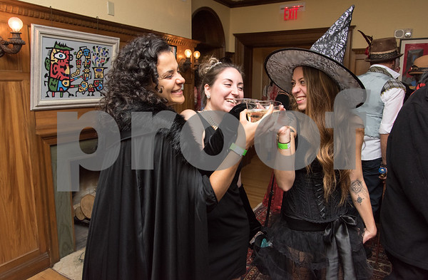 10/27/17 Wesley Bunnell | Staff The New Britain Museum of American Art held their Museum After Dark 11th Annual Halloween Bash on Friday evening. Tina Dutra, Melanie Blain and Kate Mordarski with a toast towards the end of the bash.