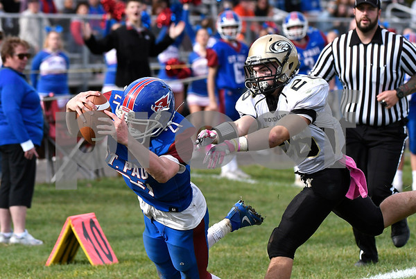 10/28/2017 Mike Orazzi | Staff St. Paul's Damien Rabis (21) and Woodland's Nicholas Rousseau (26) during Saturday's football game in Bristol.