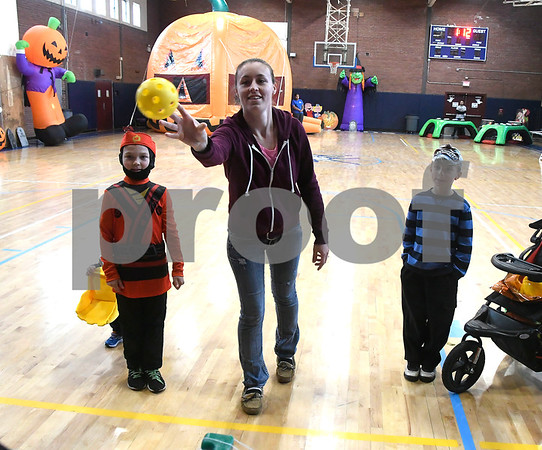 10/28/2017 Mike Orazzi | Staff Chantal Tetro, with her sons, Ryder,6 and Tanner,8, during the 13th Annual Halloween Spooktacular at the Slade Middle School in New Britain Saturday.