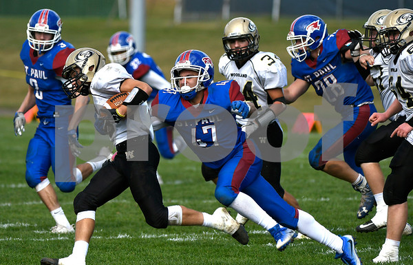 10/28/2017 Mike Orazzi | Staff St. Paul's Pedro Garcia (47) and Woodland's Zach Cochran (5) during Saturday's football game in Bristol.