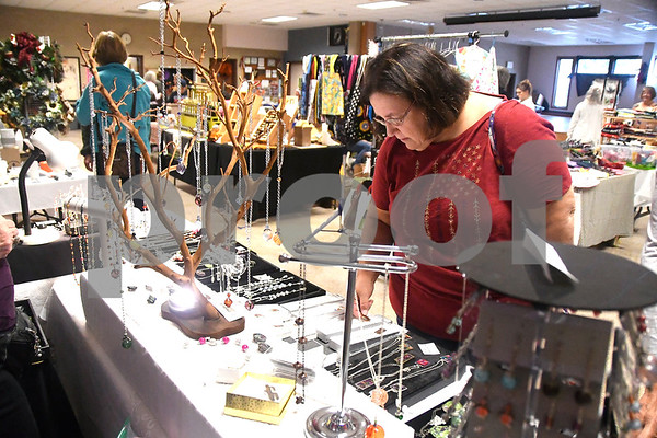 10/28/2017 Mike Orazzi | Staff Priscilla Ubysz looks over items for sale during the Bristol Senior Center Craft Fair on Saturday.
