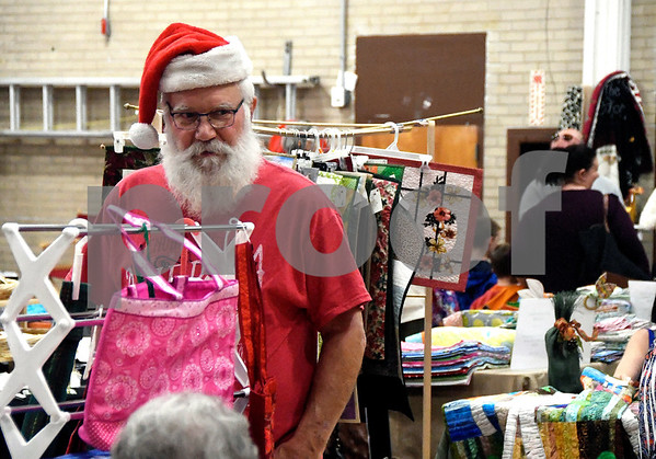 10/28/2017 Mike Orazzi | Staff Larry Zbikowski looks over items for sale during the Bristol Senior Center Craft Fair on Saturday.