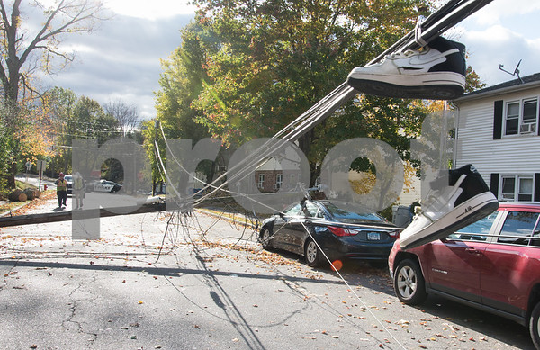 10/30/17 Wesley Bunnell   Staff At approximately 8:30pm on Sunday night a falling tree took down a utility pole and its electric lines causing a transformer to explode startling residents on Summer St. Sneakers hang from electrical wires near street level caused by a down utility pole.