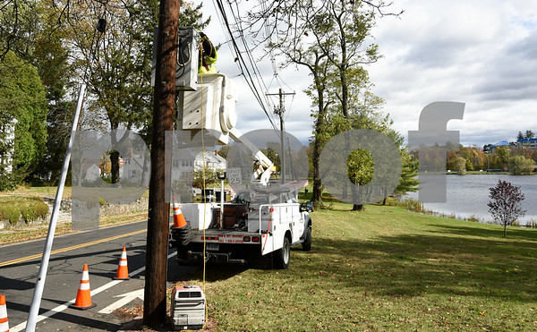 10/30/17 Wesley Bunnell | Staff High winds and heavy rain on Sunday and into Monday morning caused trees to fall and disrupt services to city residents. Comcast technicians connect a portable generator and work to restore service near the intersection of Corbin and Shuttlemeadow Ave on Monday afternoon.