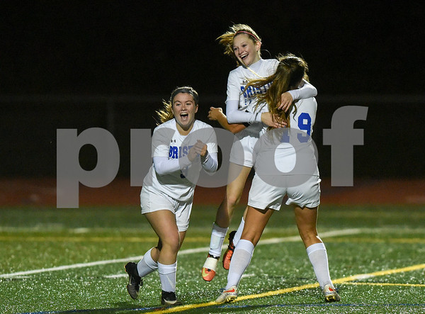10/30/17 Wesley Bunnell | Staff Bristol Central @ Bristol Eastern on Monday evening at Bristol Eastern High School. Myah Croze (9) and Brooke Dauphinee (19) congratulate freshman Kate Kozikowski (10) after scoring a goal.