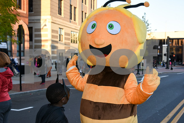 10/31/17 Wesley Bunnell | Staff The New Britain Trick or Treat Halloween Safe Zone drew a large crowd to Central Park on Halloween night. The newest mascot for Little Poland , Maja the Bee , greets a young trick or treater.