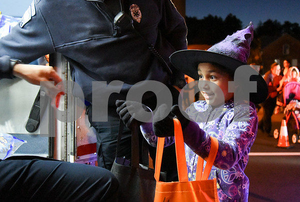 10/31/17 Wesley Bunnell | Staff The New Britain Trick or Treat Halloween Safe Zone drew a large crowd to Central Park on Halloween night. Reymaliz Lorens, age 7, holds her bag out for candy from NB EMS.