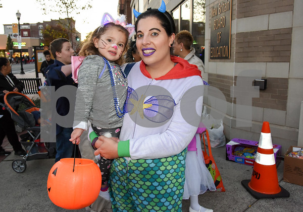 10/31/17 Wesley Bunnell | Staff The New Britain Trick or Treat Halloween Safe Zone drew a large crowd to Central Park on Halloween night. Teacher at Holmes School Adina Sanchez holds daughter Ella Sanchez, age 2.
