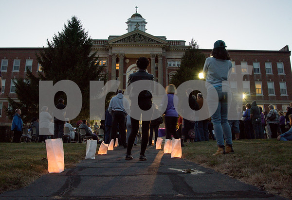 10/04/17 Wesley Bunnell | Staff Candles light the path leading up to the Prudence Crandall Center on Wednesday evening as a vigil was held in honor of those who have died due to domestic violence incidents in the past year.