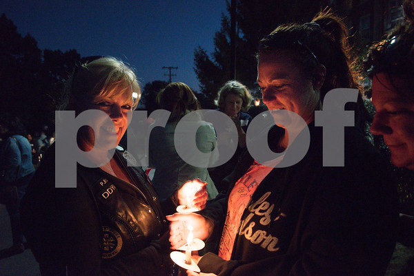 10/04/17 Wesley Bunnell | Staff Donna Pelletier, Darcy Volonino and Shannon Kelley of the Twisted Sisters MC hold lighted candles on Wednesday night outside of the Prudence Crandall Center during a vigil in honor of those killed during the last year due to domestic violence.
