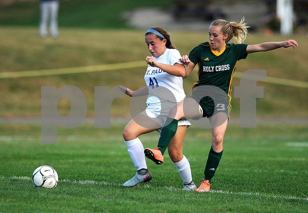 10/5/2017 Mike Orazzi | Staff Holy Cross' Erin Goggin (3) and St. Paul's Catherine Ciampi (41) in Bristol Thursday.
