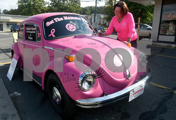 10/5/2017 Mike Orazzi | Staff Geri LaBlanc while at Harvest Bakery collecting a donations for the Beekley Center for Breast Health and Wellness at Bristol Hospital. Every $5 donation received a pink cupcake and the ability to sign the pink VW Beetle.