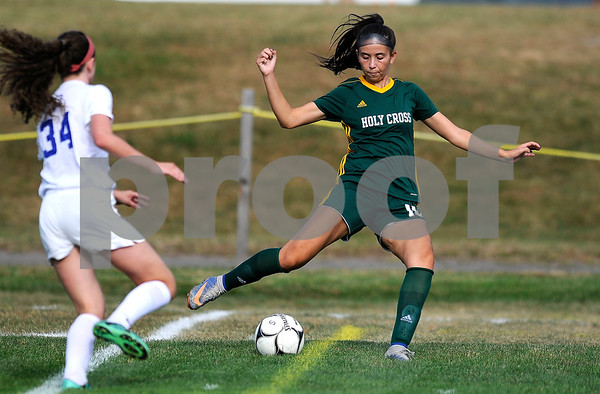 10/5/2017 Mike Orazzi | Staff Holy Cross' Adelisse Padilla (10) and St. Paul's Hannah Stanford (34) in Bristol Thursday.