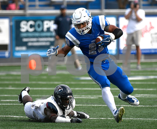 10/7/2017 Mike Orazzi | Staff CCSU's Drew Jean-Guillaume (20) the Penn Quakers' Jay Cammon Jr. (4) Saturday in New Britain.
