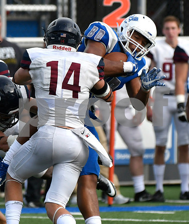 10/7/2017 Mike Orazzi | Staff CCSU's Arthur Gilmore (80) the Penn Quakers' Sam Philippi (14) Saturday in New Britain.