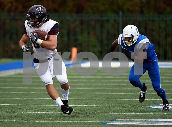 10/7/2017 Mike Orazzi | Staff CCSU's Jevon Elmore (1) and the Penn Quakers' Logan Sharp (80) Saturday in New Britain.