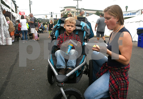 10/7/2017 Mike Orazzi | Staff Lisa Darmetko and her son Anthony 3 1/2, during the 49th Apple Harvest Festival in Southington Saturday.
