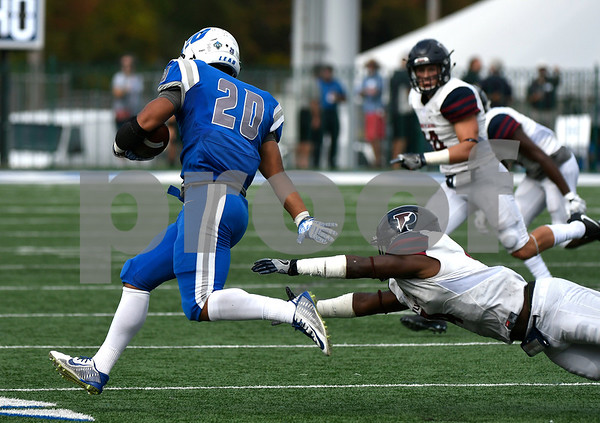 10/7/2017 Mike Orazzi | Staff CCSU's Drew Jean-Guillaume (20) and the Penn Quakers' Jay Cammon Jr. (4) Saturday in New Britain.