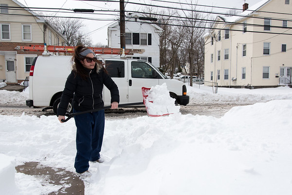 031517 Wesley Bunnell   Staff Wilmarie DelValle shovels a path near a street crossing on East St. on Wed. March 15 so her children can more easily reach their bus stop.