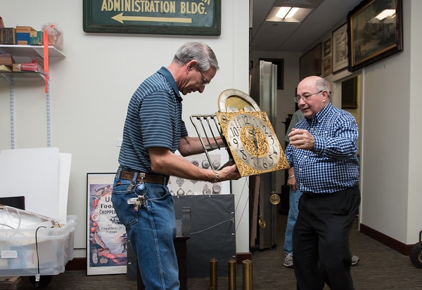 Wesley Bunnell | Staff The New Britain Industrial Museum moved the last of its collection to its new location on West Main St. in September 2017. Volunteer at American Clock and Watch Museum Bruce Thorin, L, holds the movement from a grandfather clock ready to be moved along with help from fellow museum volunteer Mel Brown.