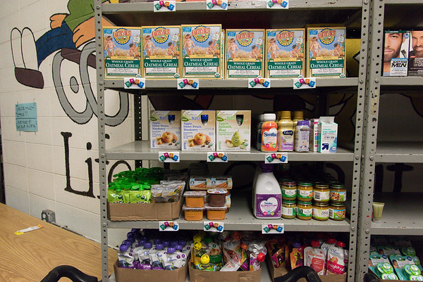 Wesley Bunnell | Staff Baby food and other items on the shelves at the HRA Food Pantry earlier this year.