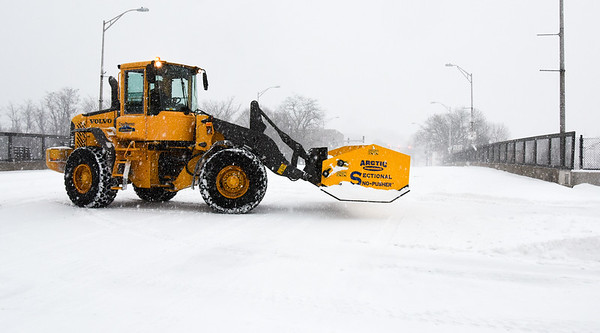031417 Wesley Bunnell | Staff Crews are shown clearing snow from the CT fastrak station in downtown New Britain on Tuesday March 14. Behind the snowblower is the Main St overpass for Route 72.