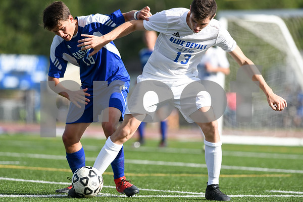 09/08/17 Wesley Bunnell | Staff Plainville Boys Soccer defeated visiting Bristol Eastern on Friday afternoon. Bristol Easterns Jake Woznicki #10 battles with Plainvilles Jake HIllburn (13).