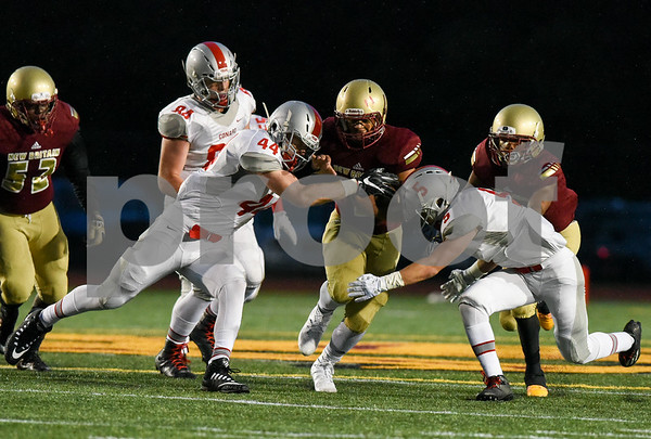 09/08/17 Wesley Bunnell | Staff New Britain High School football vs Conard at Veteran's Stadium on Friday evening. Running back Shawn Robinson (3).