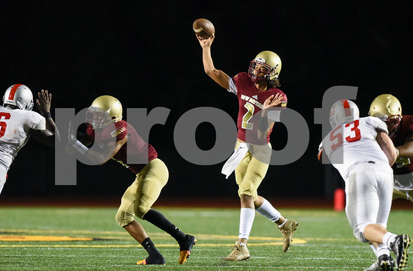 09/08/17 Wesley Bunnell | Staff New Britain High School football vs Conard at Veteran's Stadium on Friday evening. Quarterback Jahfari Newman (2).