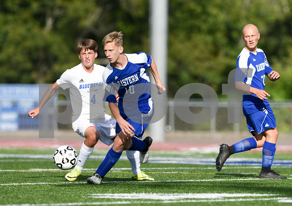 09/08/17 Wesley Bunnell | Staff Plainville Boys Soccer defeated visiting Bristol Eastern on Friday afternoon. Plainvilles Brady Beauseli (4) and Bristol Easterns Jake Woznicki #10.