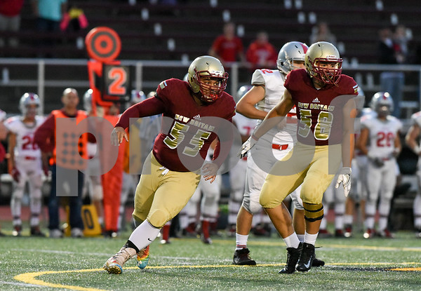 09/08/17 Wesley Bunnell | Staff New Britain High School football vs Conard at Veteran's Stadium on Friday evening. Outside linebacker Giovanii Cirrina (55) and Abner Medina (58).