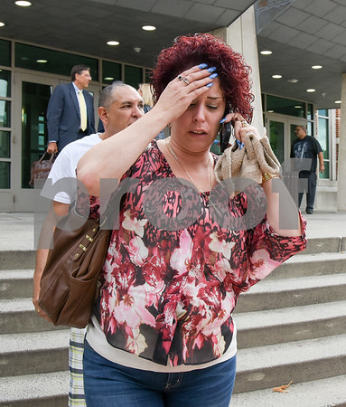 09/08/17 Wesley Bunnell | Staff Sandra Martinez leaves New Britain Superior Court on Friday afternoon after William Devin Howell pled guilty to six counts of murder. Martinez's sister Joyvaline Martinez was one of Howell's victims.