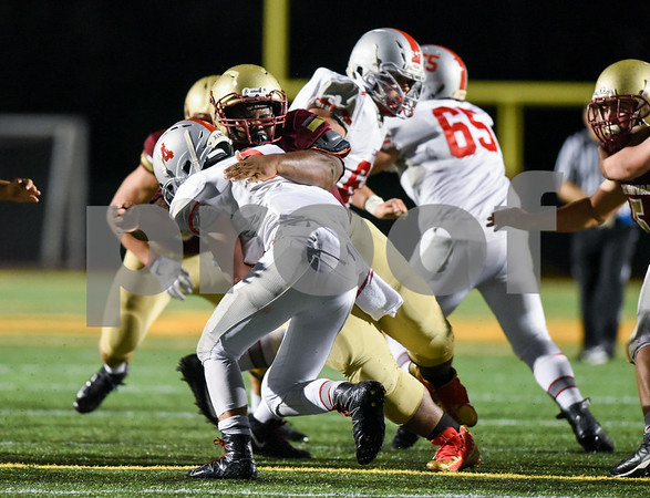 09/08/17 Wesley Bunnell | Staff New Britain High School football vs Conard at Veteran's Stadium on Friday evening. Jason Shumpert (51) with the tackle.